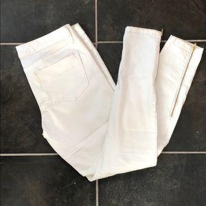 White denim leggings with gold zipper detail